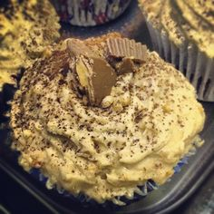 Gooey chocolate fudge cupcake with peanut butter cream icing and reese pieces