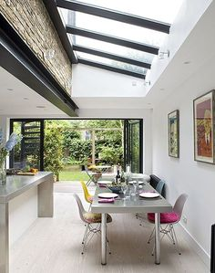 Sad colour steel beams and skylights Private House, Kentish Town Patio Interior, Interior Design, Kitchen Diner Extension, Kitchen Extension Steel Beam, Kitchen Extension Lighting, Kitchen Extension Terraced House, Orangery Extension Kitchen, Kitchen Lighting, Conservatory Kitchen
