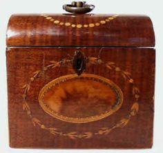Hygra: A single tea caddy in harewood with an oval medallion of figured wood Circa 1790.