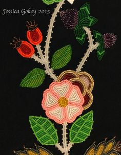 Close up on panel for MNHS Project: Designed and beaded by Jessica Gokey  Prime rose, rose hips, and clovers