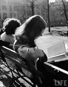 Reading in the city park...... (Photo by Nina Leen -- 1945).