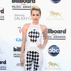 Miley Cyrus in a black-and-white jumpsuit at the Billboard Music Awards. Check out what the rest of the stars wore at Style Factor!