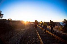 sunlight sunrise sunset sunshine people girls guys walking rail tracks road trees nature sky blue