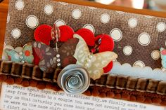 Love the paper quilled rose (at least that's what I think it is).