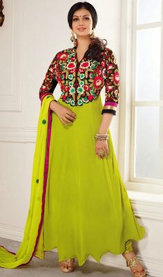 Like Ayesha Takia, stand out in this black and lime green georgette asymmetrical Anarkali suit. This enticing dress is displaying some astounding embroidery done with lace and resham work.   #LatestBollywoodFancyAnarkaliDress