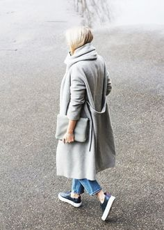 Gray coat, clutch, jeans, and leather platform sneakers