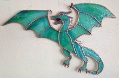 Stained Glass Dragon wall hanging. 26.5cm x 18cm Spectrum glass 6023-83cc Aqua-Lime Pearl Opal. Foil construction with copper patina finish.