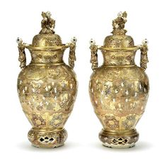A pair of large Satsuma ovoid covered vases with en-suite stands Late 19th/early 20th century (6)