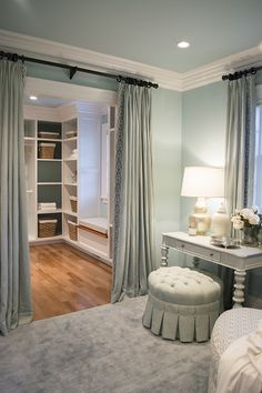 I like the idea of putting drapes on the walk-in closet in the master bathroom. Make them match the drapes in the bedroom.