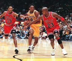 Scottie Pippen and Michael Jordan of the Chicago Bulls try to stop Kobe Bryant of the Los Angeles Lakers as he leads a fast break during their Michael Jordan Basketball, Kobe Vs Jordan, Kobe Bryant Michael Jordan, Michael Jordan Chicago Bulls, Michael Jordan High School, Sport Basketball, Basketball Legends, Basketball Players, Nba Sports