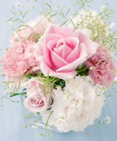 Roses and carnations in white and light pink - something small, dainty and not fussy for in the middle of the table to ground the centerpiece- put into the blue Ball jars - Anna