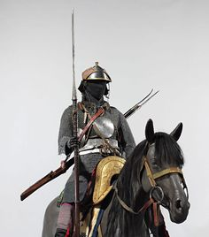 Cavalry armor, 18th–19th century Tibetan, and possibly Bhutanese and Nepalese. Iron, gold, copper alloy, wood, leather, and textile, assembled based on photographs taken in the 1930s and 1940s in the Tibetan capital of Lhasa during the Great Prayer Festival. The photographs showed troops of ceremonial armored cavalry, who wore a standardized set of equipment as stipulated by the central government of Tibet probably from the mid-seventeenth or eighteenth century onward. Met museum.