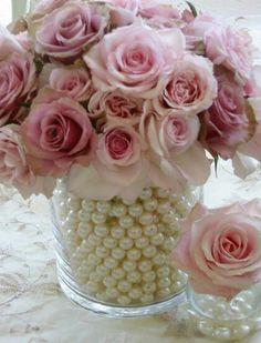 Pearls in a vase of flowers