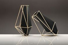 low polygon geometric vases. the combination of black and gold is amazing