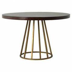 I love the base of this table | Dining table with a metallic open pedestal base and cherry wood top.