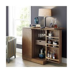 Shop Maxine Bar Cabinet.   Finished on all four sides, Maxine can float in a room.  Its wood top folds out to an expanded work surface inset with black laminate.