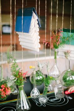 Hanging wedding centerpieces with beakers and flasks -  photo by Awake Photography, design by Jennifer Laura Design http://ruffledblog.com/industrial-science-styled-shoot/ #centerpieces