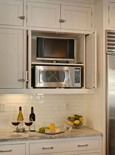 Hidden kitchen tv in cabinet with retractable doors transitional kitchen kitchen redo - Retractable kitchen cabinet doors ...