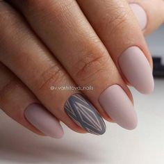 Pink beige nail polish is fine, because it helps to create very romantic manicure, which emphasizes the elegance of the nails. Make them almond-shaped and cover with nail polish. The geometrical pattern with the help of nail polish of grey hue can be made on the nail of the ring finger to intensify …