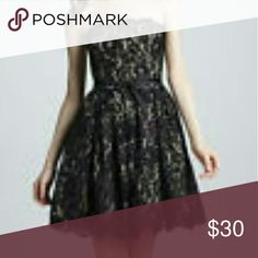 Neiman Marcus Dress Short off shoulder black lace with nude backing dress. This designer piece is sexy while still holding chic and classic impressions. A head turner in the room. Versatility makes this piece a must have as it can be worn at cocktail time, night on the town, prom night and even as a braids maid dress! Neiman Marcus Dresses Mini