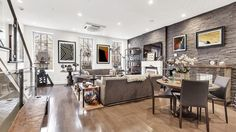 The townhouse dates to 1860 but the finishes are more 2010's bachelor chic.