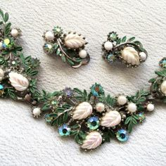 Vintage Costume Jewellery AB Green Crystal Glass Enamel Necklace Earrings Set. A pretty silver tone metal necklace and clip earring demi-parure set styled as flora and fauna with green tone aurora borealis stones, white lustre gl