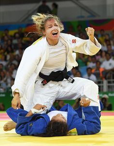TOPSHOT Spain's Laura Gomez celebrates after defeating Turkmenistan's Gulbadam Babamuratova during their women's 52kg judo contest match of the Rio...