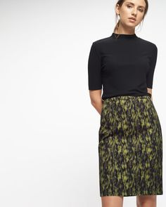 Add colour to your workwear wardrobe with this pencil skirt. Woven from a cotton…