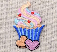 """Cupcake Iron on Embroidered Applique High quality, detailed embroidery applique. Can be sewn or ironed on. Great for hats, bags, clothing, and more! Size is approx. 1-1/4"""" x 2"""" or 3.17cm x 5.08cm"""