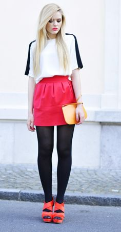 tights with red miniskirt and loose top