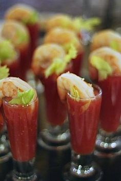 Perfect appetizer! bloody mary shooters w/ shrimp.