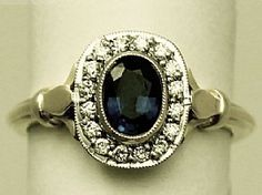 A large and impressive contemporary 0.95 carat natural blue sapphire and 0.32 carat diamond, 18 ct yellow gold ladies dress ring; part of the contemporary jewellery / jewelry collection