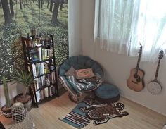 comfy little corner with guitars, rugs, books, wallpaper - nature themed and simple with light shining in