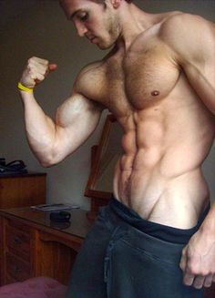 Symbolic Interactionist Theory: Adam Charlton is flexing for the camera and showing off his V. If someone hadn't told him that muscles were sexy, then he probably wouldn't have posed for this pic in the first place.
