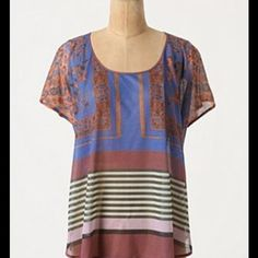 """{Anthropologie} Parquet Pullover Patterned tiles and sloped stripes are interspersed on Dream Daily by Rozae Nichols' sheer, silky tee.   Polyester  Hand wash  24""""L to front hem, 26""""L to back hem  Made in USA  In excellent condition. Anthropologie Tops"""