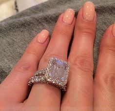 I dont know whats better, her manicure or this PHENOMENAL wedding ring! <3