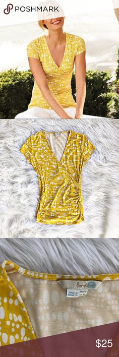 Boden polka dot wrap front jersey blouse Adorable short sleeve jersey wrap front blouse in a fun yellow and white polka dot print, size 8 from Boden. Excellent condition. Boden Tops Blouses