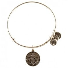 Alex and Ani Fleur de Lis Charm Bangle....ok, I think I've found something new to collect! An armful of assorted bracelets is fun.