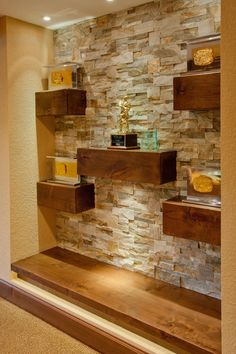 Exquisite Design Floating Shelves On Stone Wall Craftsman Style Trophy Display With Wood Shelves On Stacked Stone Wall - Shelves Design Stone Interior, Interior Walls, Interior Design, Wall Shelves Design, Wood Shelves, Floating Shelves, Glass Shelves, Living Room Wall Designs, Stone Wall Living Room