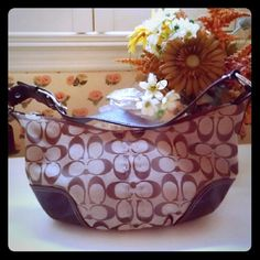 Signature Coach hobo bag Authentic Coach hobo bag. Great condition. Worn once because it was too small for me personally Coach Bags Hobos