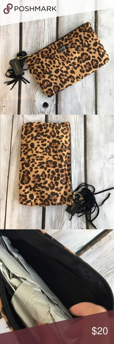 Bebe Leopard Clutch Bag Brand new with tags. Item is very soft, almost like faux suede. with a very soft texture. Bebe logo still has plastic cover on it (halfway at least). bebe Bags Cosmetic Bags & Cases