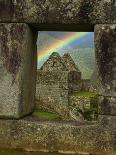 Rainbow seen through Temple of Three Windows, Machu Picchu - Perú  --  by Emily Riddell