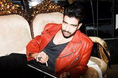 Nik Thakkar wearing an 80's red biker jacket