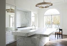 white Carrera marble kitchen, A Neuilly Apartment Design by Joseph Dirand