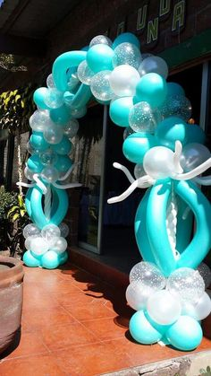 Lovely balloon arch in different shades of blue; the white and clear balloons give a nice contrast.