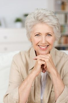 Hairstyles for women over 60 ~ This short style features lots of layers with lots of lift. A dab of mousse and a quick blow out is all this cut requires.