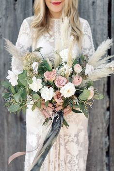 30 Spectacular Pampas Grass Wedding Decor Ideas ❤️ pampas grass wedding bohemian bridal bouquet with ribbons taralynn lawton ❤️ See more: http://www.weddingforward.com/pampas-grass-wedding/ #weddingforward #wedding #bride #bohemianweddingdecor #pampasgrasswedding