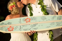 Fun for a beach wedding, ask your guests to add their messages to a surf board.