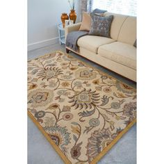@Overstock.com - Hand-tufted Coliseum Beige Floral Wool Rug - An elegant Oriental design highlights this hand-tufted wool rug. This area rug features shades of beige, gold, light blue, kerry blue, light brown, mocha brown, ivory and grey.  http://www.overstock.com/Home-Garden/Hand-tufted-Coliseum-Beige-Floral-Wool-Rug/4118643/product.html?CID=214117 $85.13