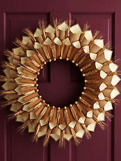 DIY Wheat & Paper Wreath - This wreath evokes a sense of warmth and charm, it's perfect for Thanksgiving! Make it using wheat stalks, construction paper, and a wreath form.